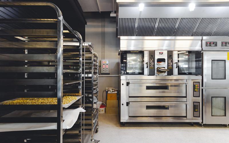 modern-pastry-kitchen-decorated-black-white-steel-with-baking-machine